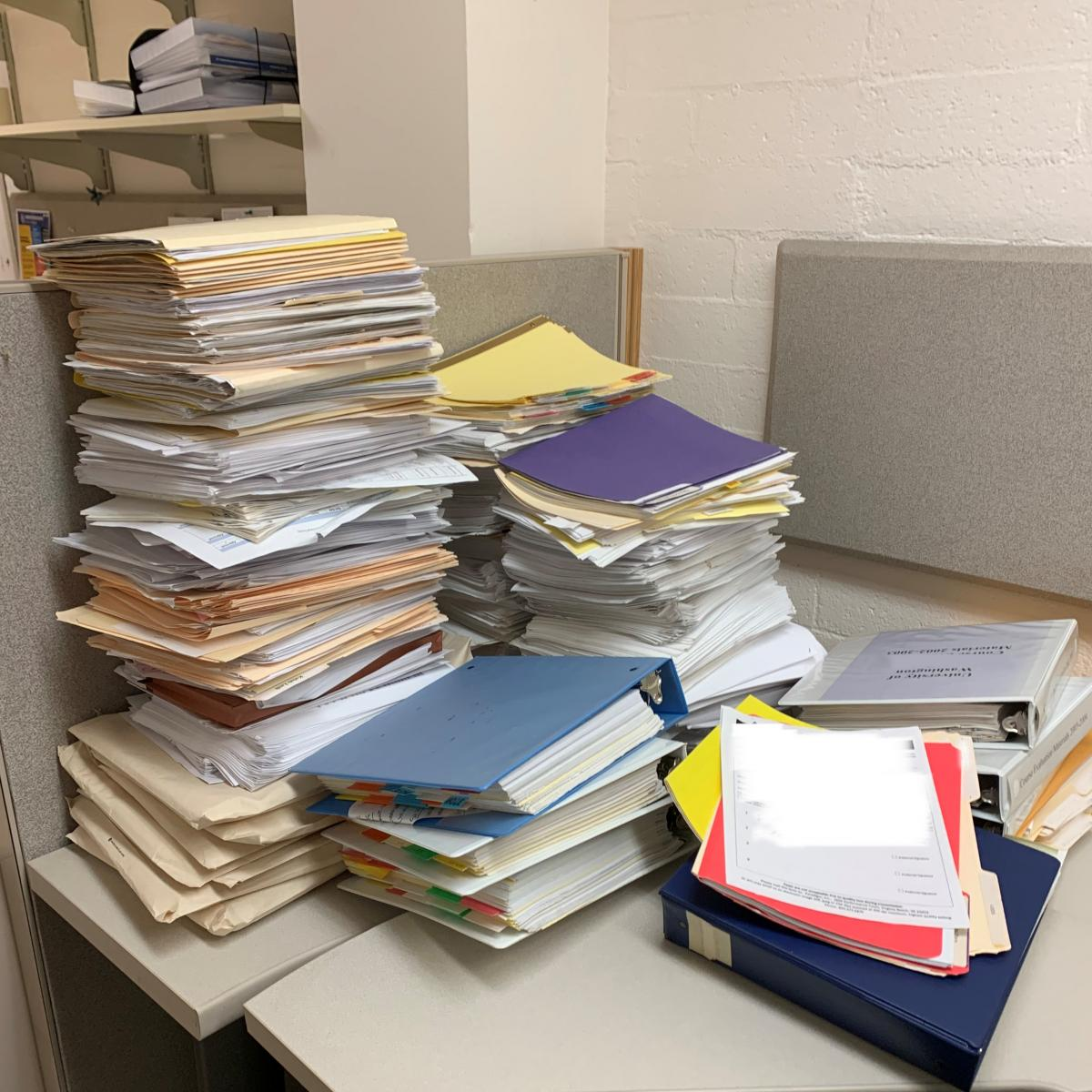 discarded ROT paper piles on desk